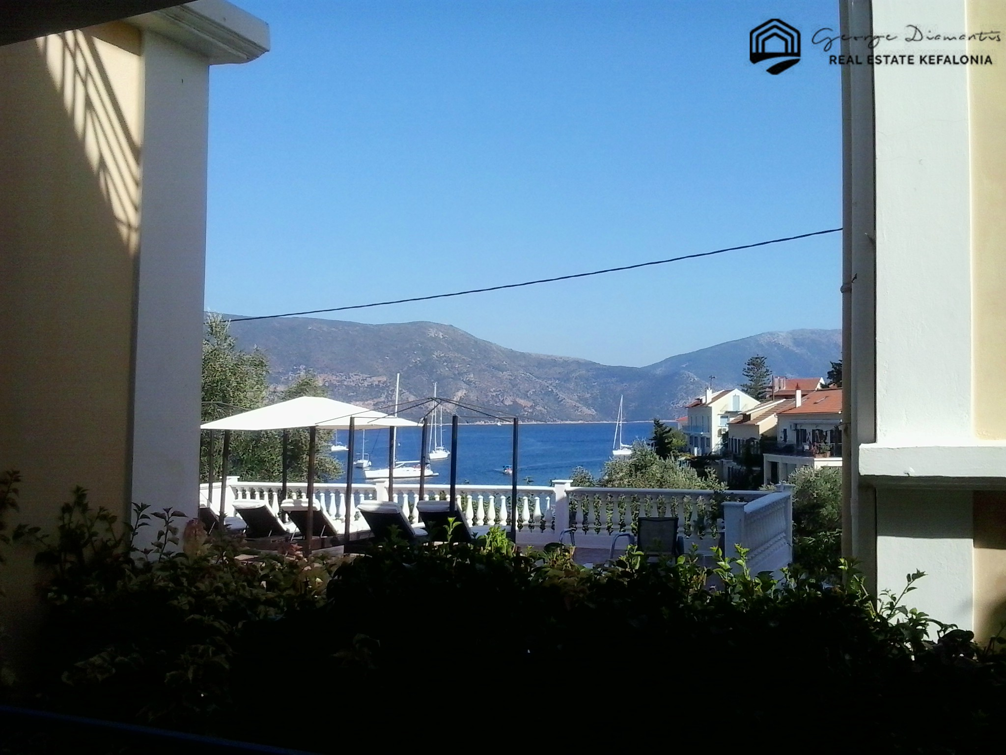 Business With Rental Rooms And Store For Sale In Fiskardo